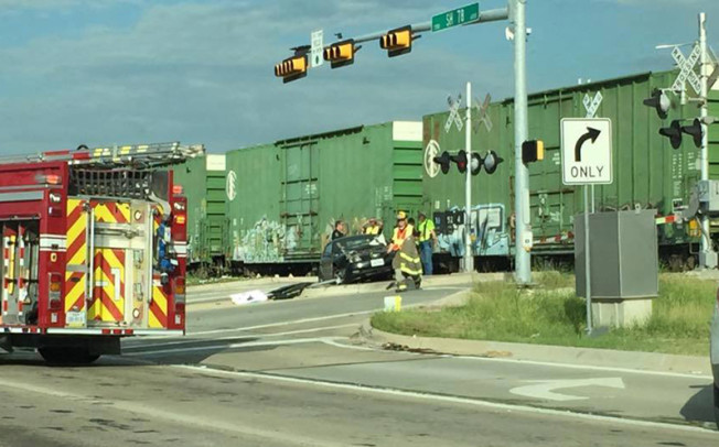 Car clipped by train