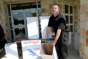 Lt. Steve Norris displays one of the many boxes of unused medicines that were taken to the DEA for disposal at the Drug Take Back event Sept. 26.