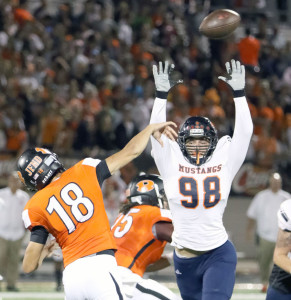 Joe Diehl/The Sachse News Sachse's Tony Krasniqi (98) attempts to block Will Reed's throw during last Friday's loss at Rockwall. The Mustangs (2-2 in District 11-6A) will look to get back to winning this Friday against Naaman Forest.