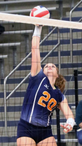 Joe Diehl/The Sachse News From left, senior Erin Richburg (20) was named the District 11-6A MVP for 2015, while fellow senior Casey Enna was the Setter of the Year. Also earning individual accolades was Rikki Jones, who was named Coach of the Year.