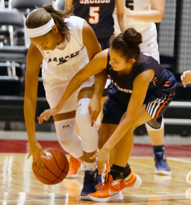 Joe Diehl/The Sachse News Edith Velasquez, here battling for a loose ball, is one of the players tasked with playing guard for Sachse.