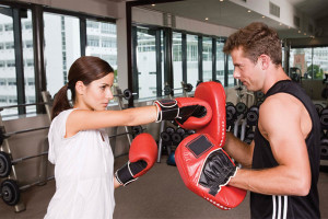 Committing to multiple personal training sessions as opposed to paying on a session-by-session basis is one potential way to save money when trying to get in shape.