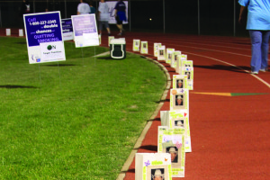 Luminaria bags line the track at the 2015 Relay for Life event. The bags are in remembrance of friends and loved ones who lost their battle with cancer.