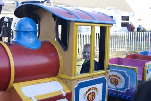 Jennifer M. Aguilar/The Sachse News Luke Morris, 4, of Wylie, enjoys a mini train ride at the Carson & Barnes Circus hosted by the Chamber of Commerce March 24.