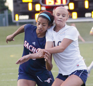 Joe Diehl/The Sachse News Cyera Hintzen, left, battled an HP player during the April 1 area-round match in Lake Highlands.