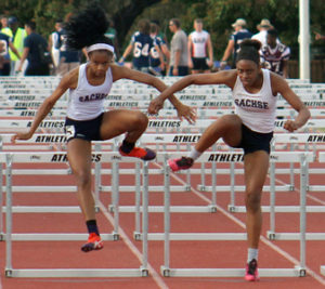 Greg Ford/The Sachse News Sachse's La Laylah Pleasant and Zuri Sheppard prepare to head for the finish line during the District 11-6A 110 hurdles, which took place last week at Williams Stadium.  Sheppard finished first, followed by Pleasant, which qualified each for the area meet with District 5-6A.