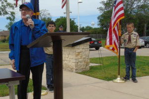 Ken Earman was the featured speaker at the city of Sachse's Memorial Day ceremony Monday. He recounted his experiences as an Army Air corpsman during World War II. The 95-year-old veteran flew B-24 bombers in the Pacific. He said that the war touched everyone in the world. He survived 40-plus missions and said his unit bombed every island in the Pacific. Members of Cub Scout Pack 243 stand at attention.