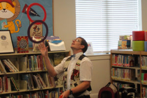 The library rings in a hit with the children as Dazzling Dave performs at the Sachse Library as part of the Summer Reading Program June 8.