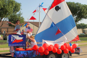 The Lavon Yacht Club sailed away with third place in the parade at the July 2 Red, White, and Blue Blast. Floats, cars, and those on foot started at the Sachse Library and ended at Heritage Park.