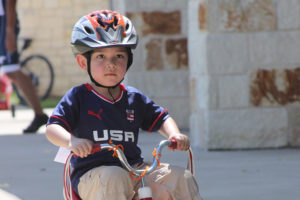 Three year old Pablo Vargus pedals intently despite the heat during the Bike Rodeo hosted by the Sachse Public Library July 7. Volunteers were plentiful and included Mountain Bike Club members from Sachse High School, Richardson Bike Mart, Boys Scout Troop 442 and the Sachse Police Department.