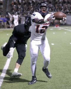 Joe Diehl/The Sachse News DeAndre Kennedy (12) reaches in an attempt to make a fingertip catch. The senior pulled in two passes for 22 yards.