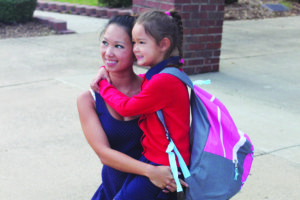 Ryleigh Duckworth and her mother Tina Nguyen are equally excited about Ryleigh's first day of school as she begins kindergarten at Sewell Elementary.
