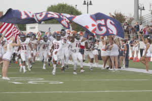 Members of the Sachse football team head on to the field prior to the start of last Friday's 2016 season opener at Byron Nelson. The Mustangs prevailed 47-41 in overtime, and will go for win No. 2 tonight against Plano West at Williams Stadium.