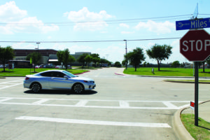 A car passes the entrance to Sachse High School, where city officials are possibly looking at widening the right turn lane and constructing a pedestrian island.
