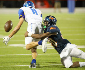 Joe Diehl/The Sachse News Chris Washington (20) strips the ball from the Bulldawgs' Floyd Connell.