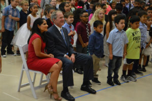 Courtesy Michael Turner/Wylie East student Former President George W. Bush and Maricela Helm, principal of George W. Bush Elementary School, pose for a picture with students at a ceremon dedicating the newest Wylie Independent School District campus.