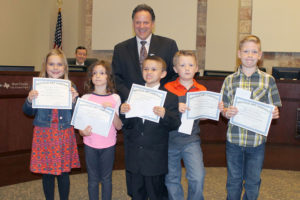 Sachse Mayor Mike Felix poses with Cox Elementary students who were named the 2016 Recycle Art Contest winners. The students were assigned to create a piece of artwork made from recycled material. The recipients were Emma Monte (kindergarten), Gavin Avila (first grade), Bear Frazier (second grade), Landry Trent (third grade) and Bennet Cowdrey (fourth grade).