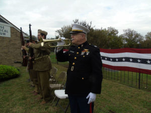 Larry Quave plays taps on a 75-year-old bugle during the annual SHS Veterans Day program Saturday, Nov. 5. The antique bugle was used by a Marine Corps musician at Pearl Harbor in 1941.