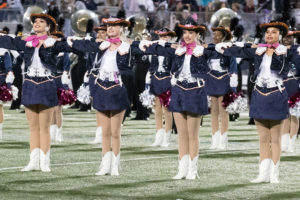 It's not always smiles for the Sachse Swingsters, who must endure many hours of work during the week before a game. After the football season, the drill team will then take part in competitions through the end of the school year.