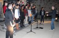 Choral group carols through Christmas