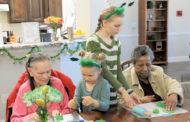 Family serves at senior living community