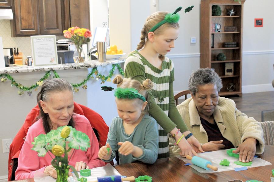 Family serves at senior living community