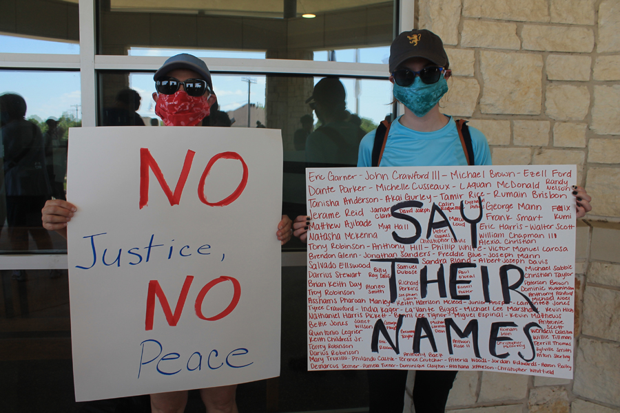 Nearly 200 gather to peacefully protest
